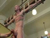 Muscle stud Mitch Vaughn is suspended crucifix style and edged to a point of insanity.