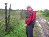 pissing by fence in the countryside