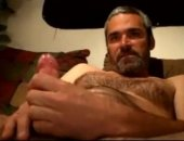 beefy mature dude with a bear jerking off