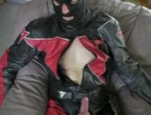 leather bear showing off his gear