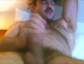 hairy bear milking his cock