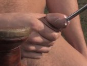 Hot Guy inserting a metal rod on his cock.