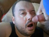 Mature Bears Giving a blowjob and takes facial cumshot.