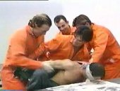 a group of prisoners gangbang a cop.