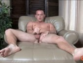 a hot jock jacking his dick on the bed