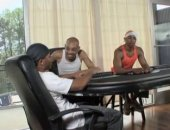 black guys sitting around the poker table.