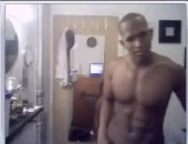 Beating his long black dick and showing off his amazing chest and six pack abs.