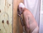 We put a hot silverbear behind the gloryhole and waited for a cock for him to pleasure and it sure didnt take long before some guy stuck his cock in that hole!