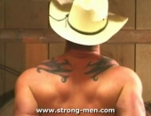 A sexy muscle stud striping. Showing off his rippling muscles and sexy throbbing cock