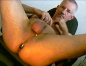 Mature Older bear plays with his ass. Rubbing his cock and balls and then pulling out a computer mouse to shove up his willing asshole