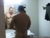 We have these hot gay bear taking a shower as he prepares for his duty. Watch as he washes those hairy exterior and gets dressed up for his cop duty