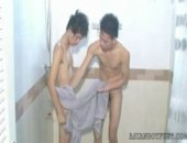 After cleansing his feet in the shower, Asian boy Mickey (with pierced nipples) moves to the bedroom to dry of each body part one after the other....