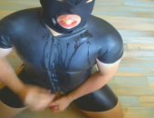he swallows stale seed in his rubber suit