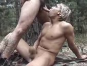 Blonde Guy Sucking Cock in the Jungle.