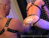 Eric Michaels in his boots, black leather jock framing his square ass and arm bands pairs up with the well-inked Bobby Black for what seems like an hour of fist-ass punching. Both are men  really get into it here, in a performance that will leave you gasping