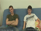 Couple straight boys relaxing and posing excited bodies on sofa.