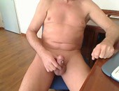 Naked dude at home with a cock ring masturbating for the webcam