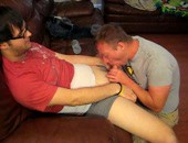 Nerdy amateur dudes sucking cock in their living room for fun