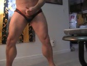 Homemade muscular dude wanks his meat at home in some tight ass shorts
