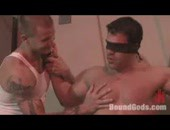 Two muscle bodybuilders in sex domination inside the gym