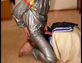 humping track pants in a silver track suit