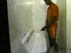 Black Marine jerking his cock in the bathroom. This black hunk loves to jerk in public and try to get away with it!