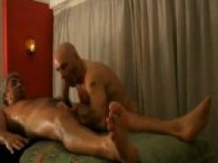 Sexy Silverfox getting a rubdown from a beefy hunk. this masseuse has no issue with bringing out some other tools..like his tongue!