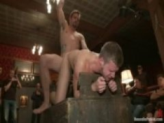 Brian Bonds gets his ass punished by a room full of horny men