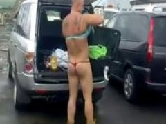 nude guy in ladies underwear in a parking lot