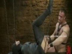 Gay man with large shoulders and tattooes gets spanked and fucked in bdsm fetish sex screaming with his cock erected