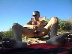horny mature dude gets his fill in the sand