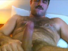 this mature hairy man licks his own load