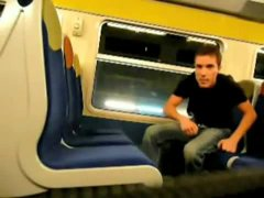 stroking a nice uncut cock on a train