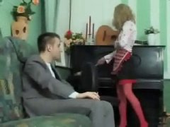 dude dressed like a maid blows his boss in the living room