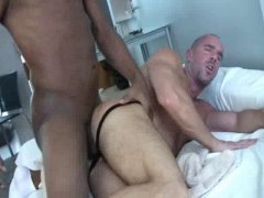 big black cock fucks a load into a white hunks ass and makes him piss it back out