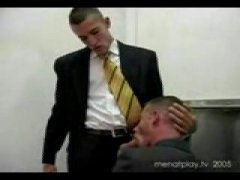 hot guys in suits take a break to suck each other off in the bathroom when a 3rd dude intercepts through a glory hole