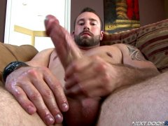 hairy bearded guy stroking his greased up dick