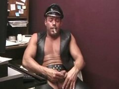 leather daddy smoki a cigar and showing off his cock
