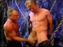 Hot Chained Blonde Guy GOt His Cock Jerked.