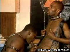 Black Gay in Leather Sucking Cock and Licking Ass.