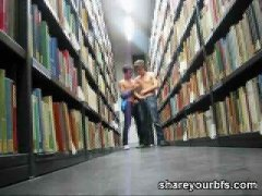 Horny COuple Kissing in the Library