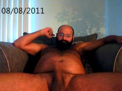 jerking his hairy cock for you.