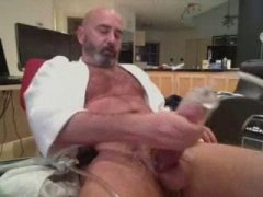playing with his toy on his dick.
