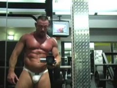 gorgeous man in the gym with his huge muscles.