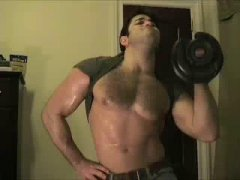 strong guy alone on cam working out.