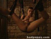 Fetish model Jack hangs in a sling with his feet in the air, showing off his hairy hole while he jacks his throbbing uncut cock!