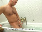 Amateur man jerking off in the bathroom.