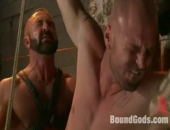 Muscle *********** suspends his ripped boy in the dungeon and fucks the hell out of him.