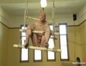 Bodybuilder John Magnum gets tied up, suspended, dildo fucked and edged.
