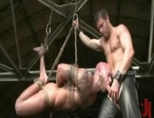 Gay master in leather trains bondage sex slave with clips spanking and extreme fucking in this kinky video scene